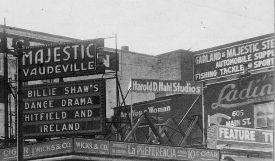 Majestic Vaudeville billboard, 1914,  in Houston at the corner of Main and Texas. People go about their business on a Houston street corner around 1915. Photo: File Photo / Handout