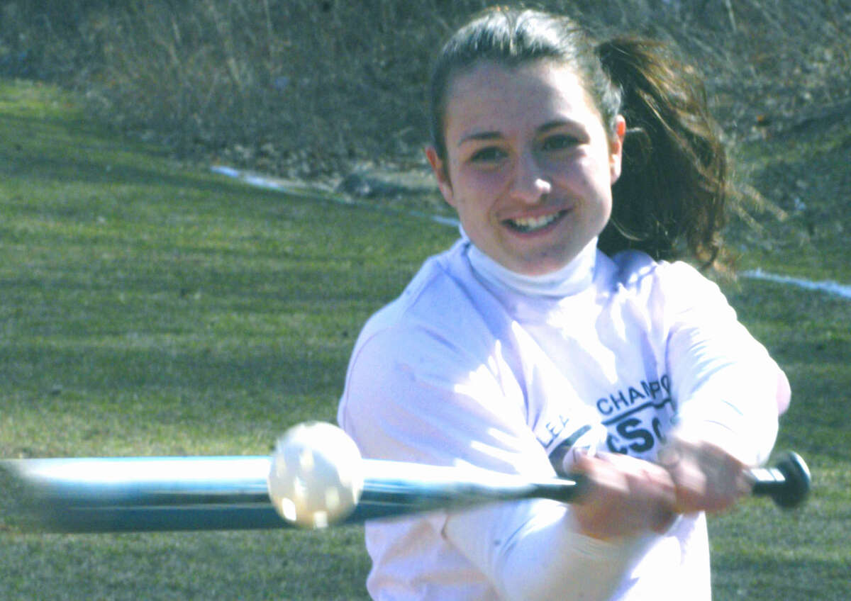 Emilie Zarba of the Green Wave revels as she swats a wiffle ball during pre-season practice for New Milford High School softball. April 2013