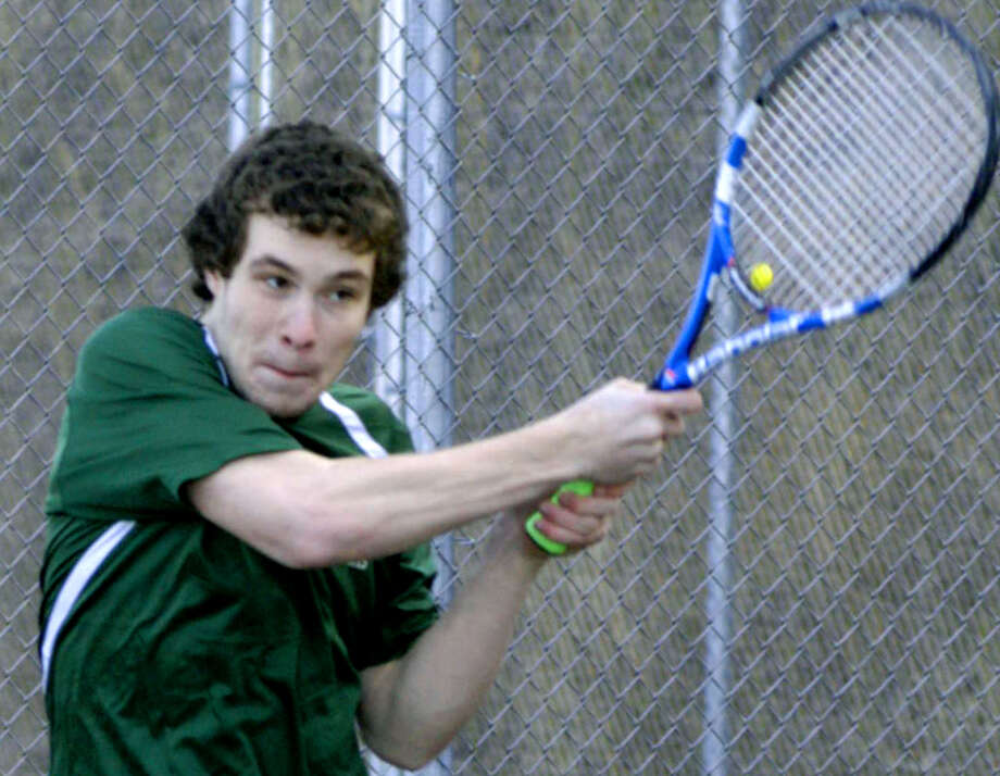The Green Wave's Nick Eherts follws through on a backhand smash for New Milford High School boys' tennis, April 2013 Photo: Norm Cummings