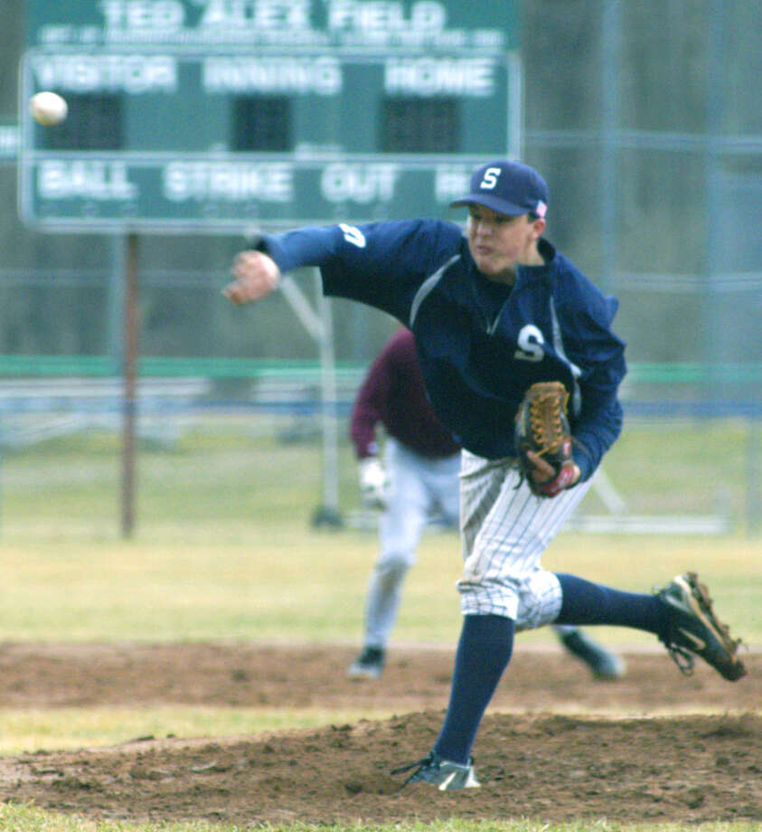 Gavin Hauspurg of the Spartans fires a high, hard one to a Torrington batter during a pre-season scrimmage for Shepaug Valley High School baseball at Alex Field in Washington Depot. April 2013 Photo: Norm Cummings