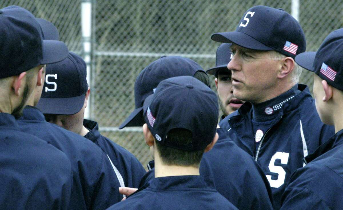Spartan coach Scott Werkhoven offers final words of counseling to his players prior to a pre-season scrimmage for Shepaug Valley High School baseball. April 2013