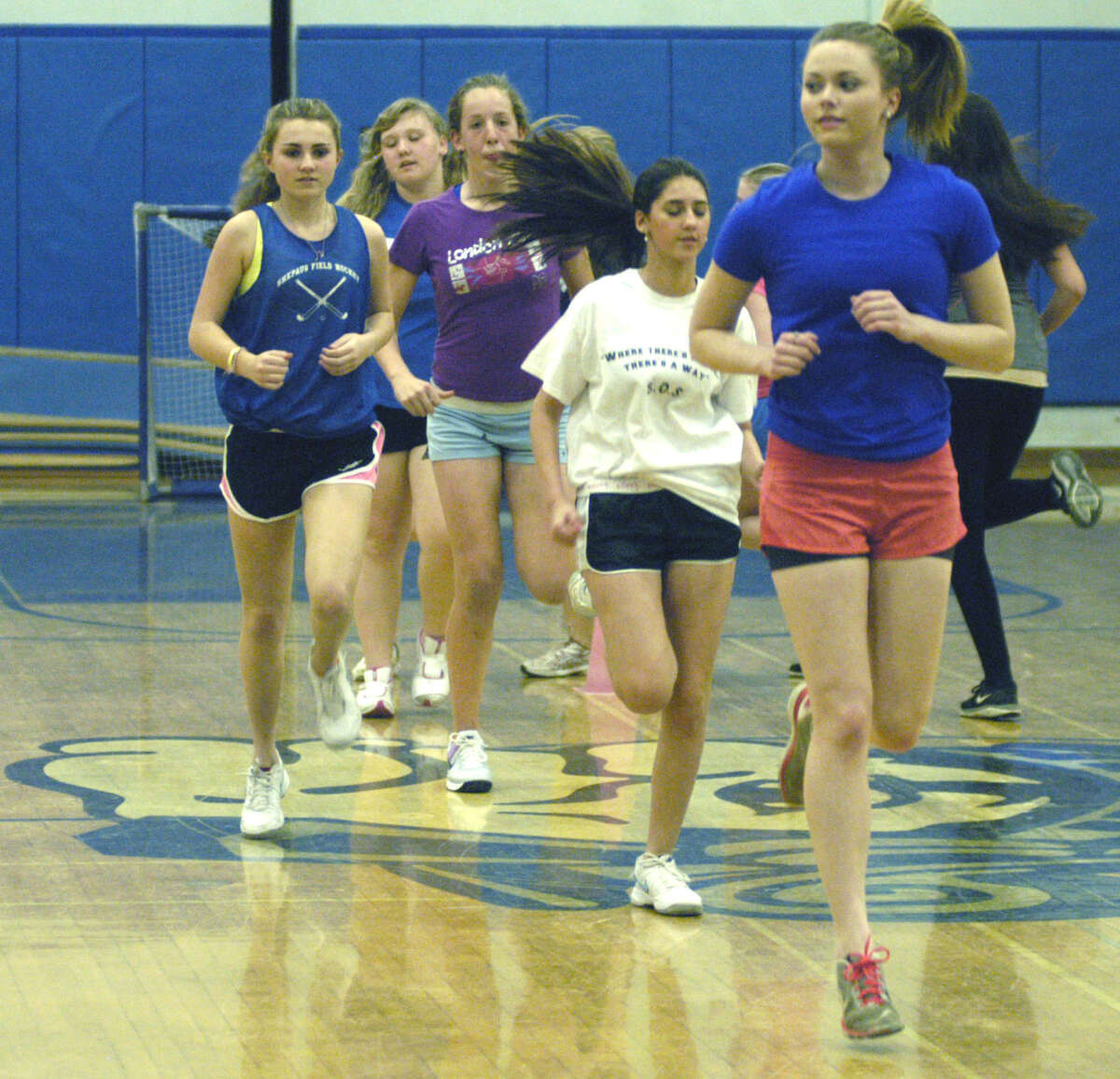 Emma Landegren leads the Spartans as they do a quick lap to warm up for indoor practice for the Shepaug Valley High School girls' tennis season. April 2013