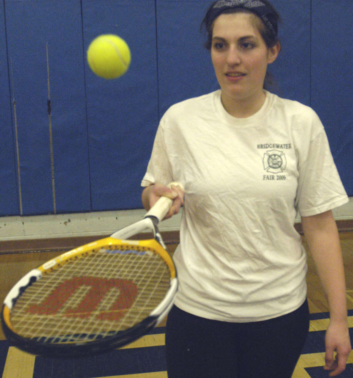 The Spartans' Emily Deanne works on her dexterity with the racquet during practice for Shepaug Valley High School girls' tennis. April 2013