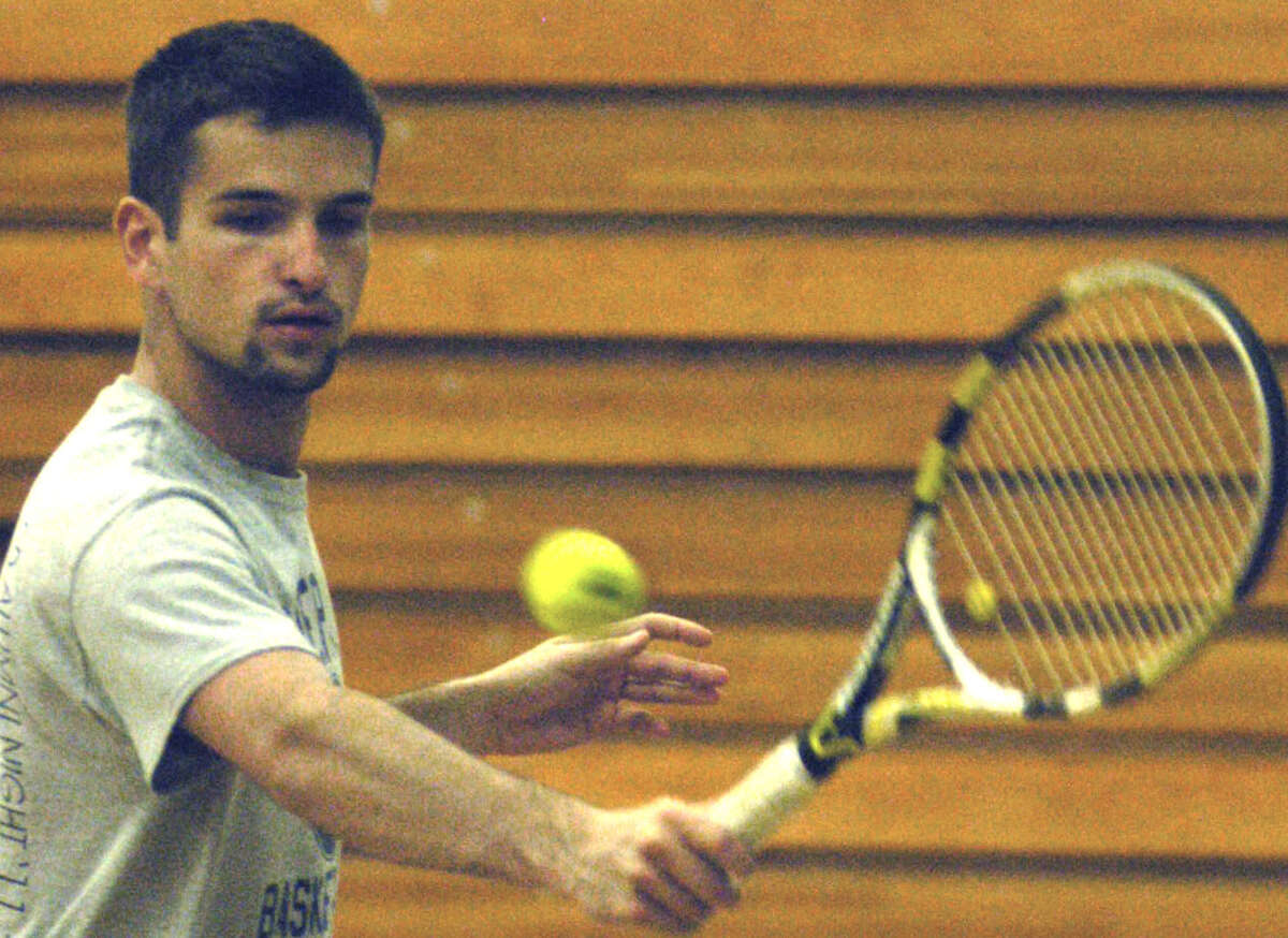 Kellen Rikhoff of the Spartans deftly crafts a backhand during indoor practice on a rainy day for Shepaug Valley High School boys' tennis. April 2013