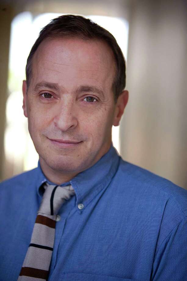 "David Sedaris, author of ""When You Are Engulfed in Flames,"" poses in this handout photo taken on March 3, 2008. The 323 page book is published by the Little, Brown unit of Hachette Book Group and retails for $25.99. Photographer: Anne Fishbein/Hachette Book Group via Bloomberg News Photo: ANNE FISHBEIN / HACHETTE BOOK GROUP"