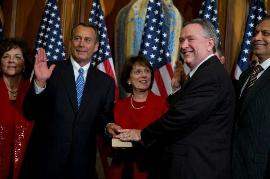 Rep. Steve Stockman, R-Texas, second from right, participates in a mock swearing-in ceremony with Speaker of the House Rep. John Boehner, R-Ohio, for the 113th Congress on Thursday, Jan. 3, 2013 in Washington. Photo: Evan Vucci, AP Photo