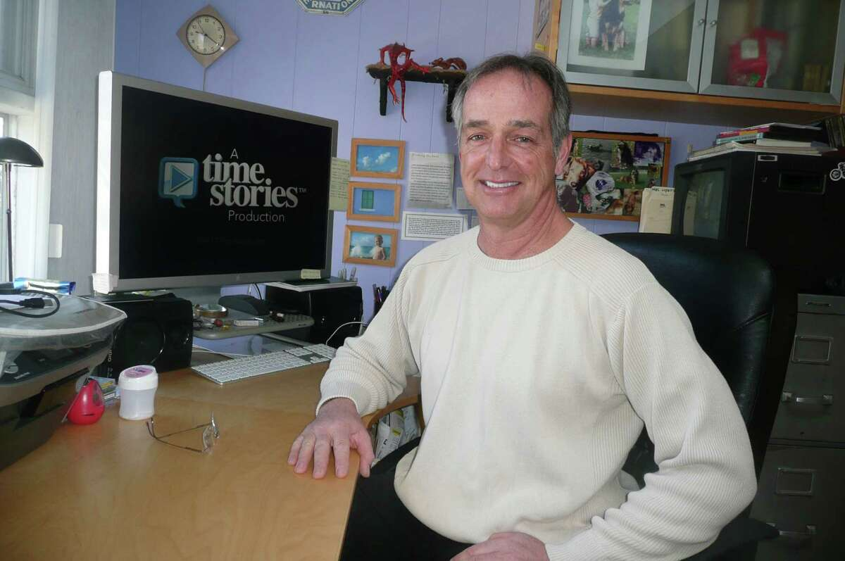 """Peter Savigny, seen here in his White Plains, N.Y. studio, is a specialist in film story telling and preserving family histories on video. He filmed the 46 different family narratives currently on view in the Greenwich Historical Society's exhibit, """"From Italy to America."""" As part of that exhibit, he will give a talk on how to preserve your family history."""