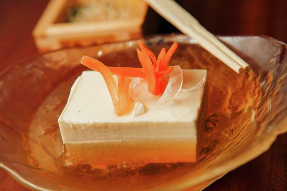 A dish of chilled mass tofu at Yopparai, an izakaya, in New York, March 29, 2013. Japanese pubs called izakayas give both customers and chefs a space to get a little messy. (Danny Ghitis/The New York Times) Photo: DANNY GHITIS / Danny Ghitis