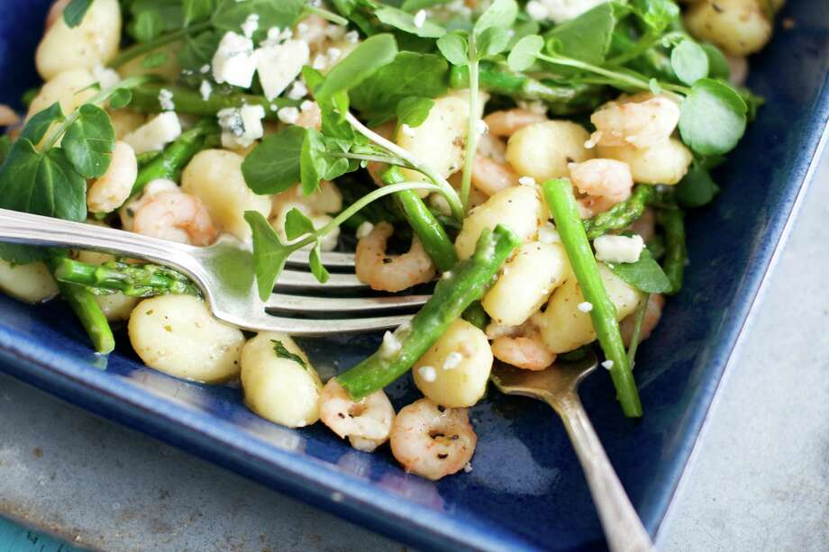 In this image taken on March 18, 2013, spring gnocchi with asparagus and shrimp is shown in a serving dish in Concord, N.H. (AP Photo/Matthew Mead) Photo: MATTHEW MEAD