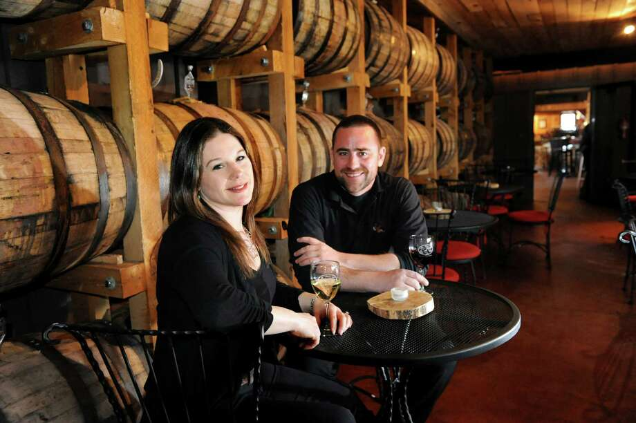 Owners Tara and Rich Nimmo sit with a glass of wine in the Barrel Room, where wine ferments, on Friday, April 5, 2013, at The Saratoga Winery in Milton, N.Y. (Cindy Schultz / Times Union) Photo: Cindy Schultz / 10021853A