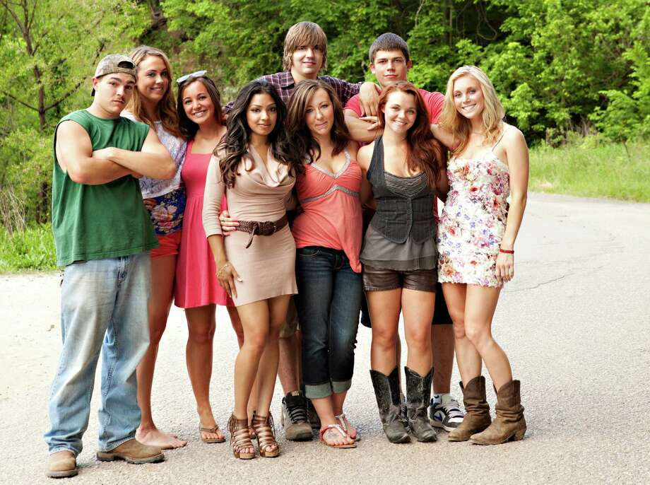 "FILE - This undated image originally released by MTV shows the cast of the new reality series ""Buckwild,"" from left, Shain Gandee, Anna, Katie, Salwa, Joey, background center, Ashley, Tyler, background right, Cara and Shae. MTV said Wednesday, April 10, 2013, it is canceling its West Virginia-based reality TV show ""Buckwild"" a week after the accidental death of 21-year-old star Shain Gandee. Network spokesman Jake Urbanski confirmed the news, saying it was ""not an easy decision."" (AP Photo/MTV, file) Photo: Uncredited"