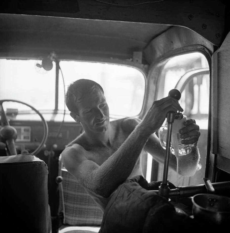"American surfer Bob ""Hammerhead"" Gravage pours beer from the keg in his car at the beach, San Onofre, California, July 1950. Photo: Loomis Dean, File / Time & Life Pictures"