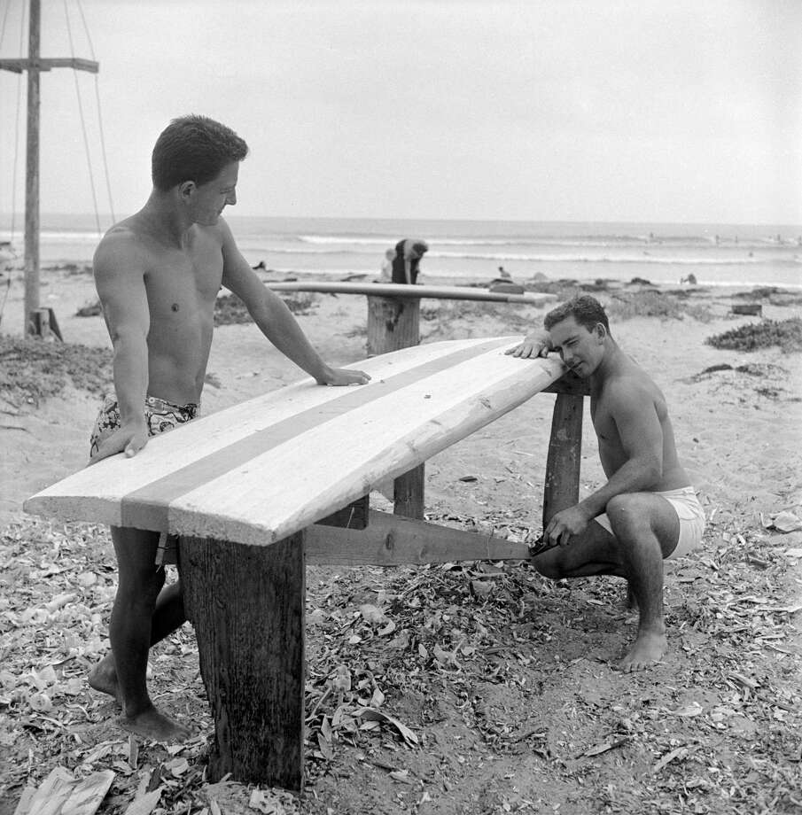 A pair of unidentified surfers shape their surf boards on the beach, San Onofre, California, July 1950. Photo: Loomis Dean, File / Time & Life Pictures