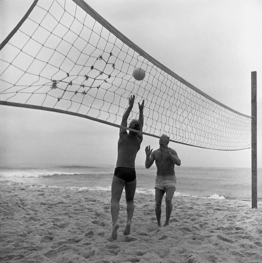 Two unidentified men play vollyball on the beach, California, July 1950. Photo: Loomis Dean, File / Time & Life Pictures