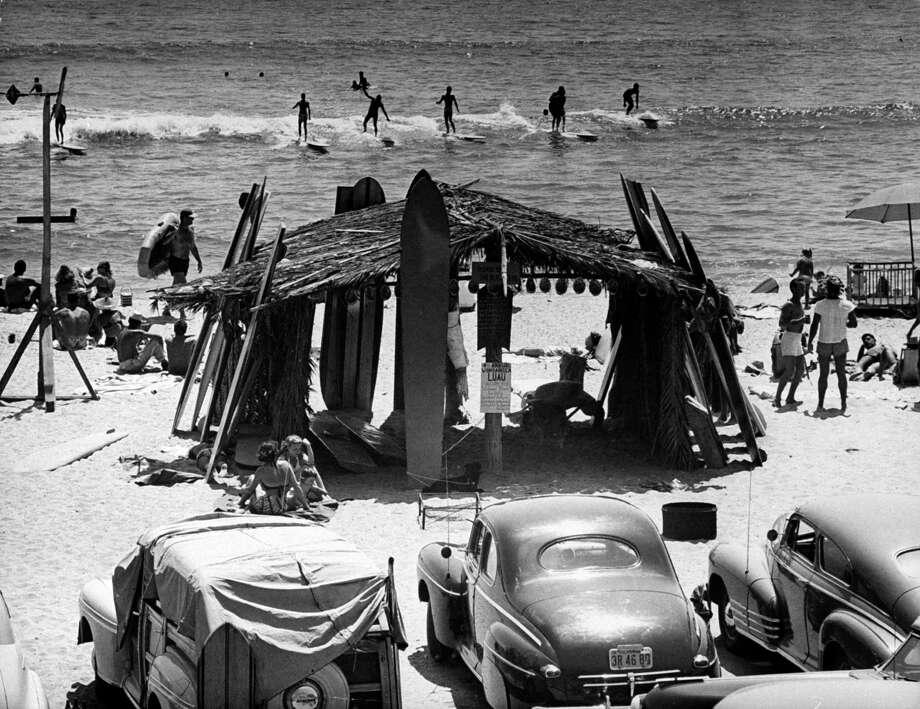 Surfboards resting against thatched hut that was built by beach bums. Photo: Loomis Dean., File / Time & Life Pictures