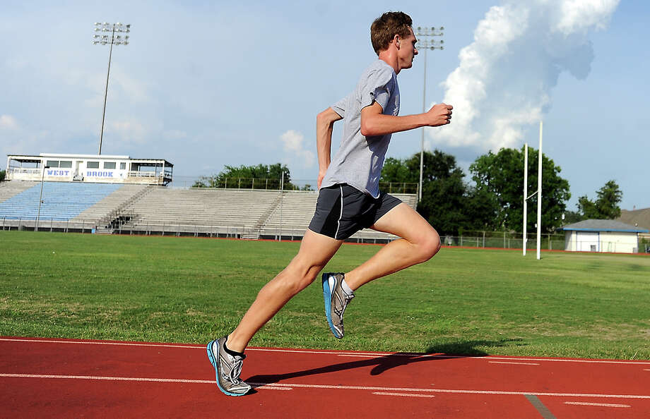 Tye Norman warms up for his workout at West Brook High School in Beaumont, Friday, July 6, 2012. Norman will run the 2,000 meter steeplechase at the AAU Track and Field Nationals. Tammy McKinley/The Enterprise Photo: TAMMY MCKINLEY