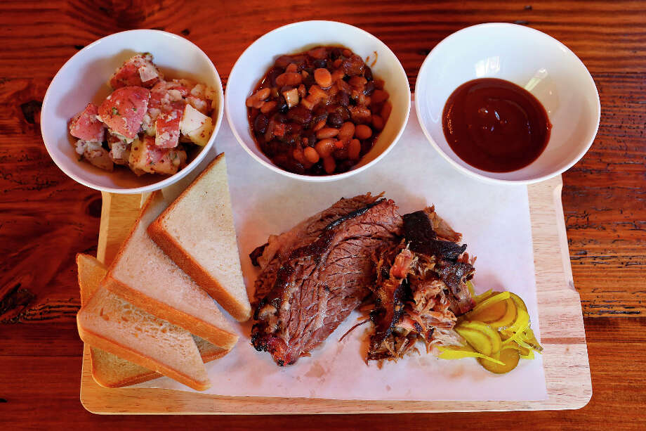 Barbecue Board: market style fare served with baked beans, potato salad, buttermilk bread, pickles and 'cue sauce, at The Granary in the Pearl Brewery complex. Photo: Lisa Krantz, San Antonio Express-News / © 2012 San Antonio Express-News
