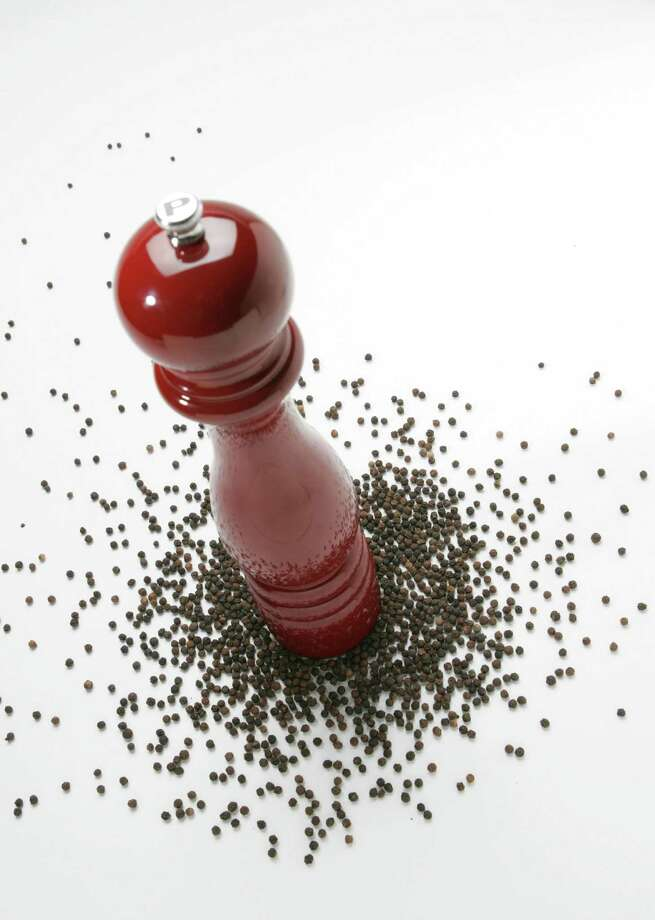 Peppercorns come in a variety of colors, and each spices and flavors food in its own way. (Glenn Koenig/Los Angeles Times/MCT) Photo: Glenn Koenig, MCT / Los Angeles Times