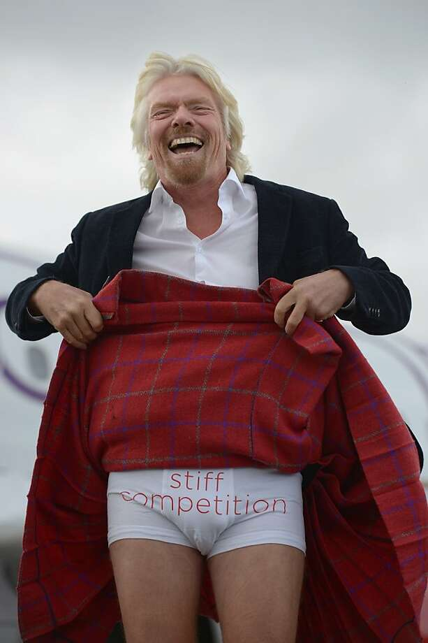 While most Scots go au naturel under their kilts,Englishman Sir Richard Branson opts for tighty-whities. The founder and chairman of the Virgin Group arrived in Edinburgh aboard the inaugural Virgin Atlantic Little Red flight, which will be operating three domestic services between London Heathrow and Edinburgh, as well as Aberdeen and Manchester. Photo: Jeff J Mitchell, Getty Images