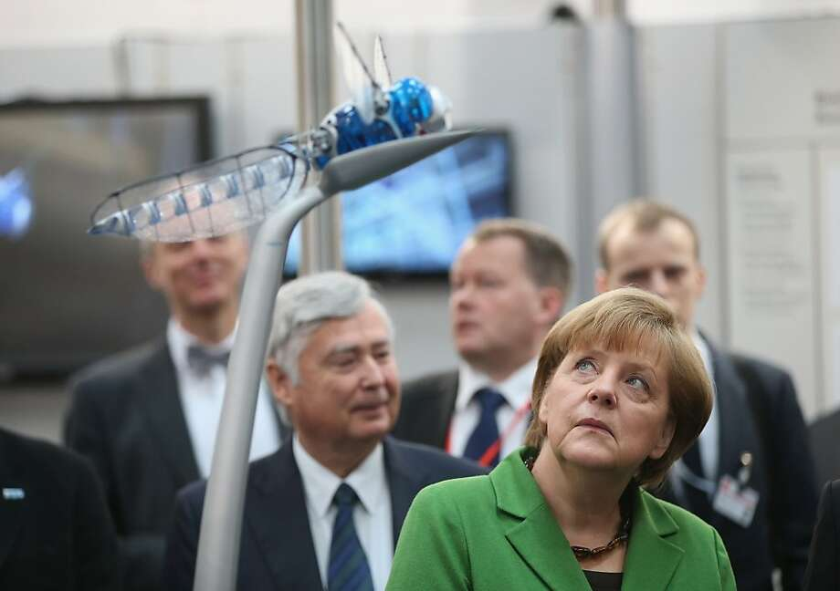 Surveillance bug: German Chancellor Angela Merkel looks at a BionicOpter, a remote-controlled drone resembling a giant dragonfly at the Hannover Messe industrial trade fair in Hanover, Germany. Photo: Sean Gallup, Getty Images