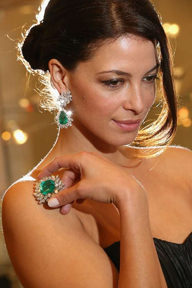 No, most people don't wear broaches on their shoulders, but I'm not most people … A model at Sotheby's auction house shows emerald-and-diamond ear clips and a matching broach from the collection of actress Gina Lollobrigida in London. The set was expected to sell for roughly $300,000 at auction next month. Photo: Oli Scarff, Getty Images