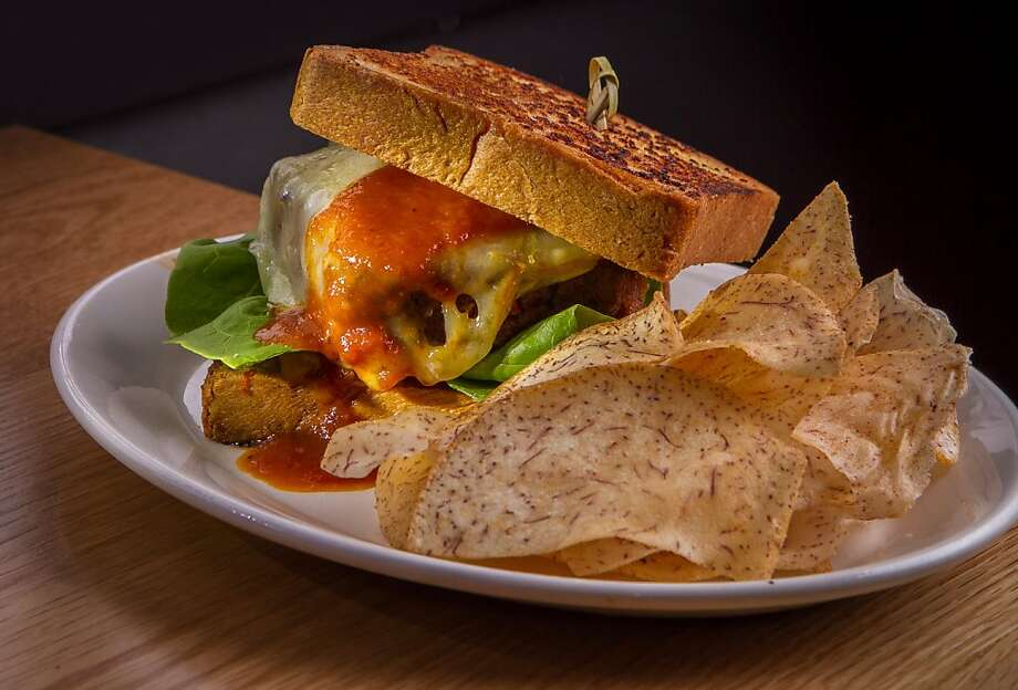 The meat loaf sandwich, served with cheddar cheese between thick slices of garlic Texas toast, is appropriately messy. Photo: John Storey, Special To The Chronicle