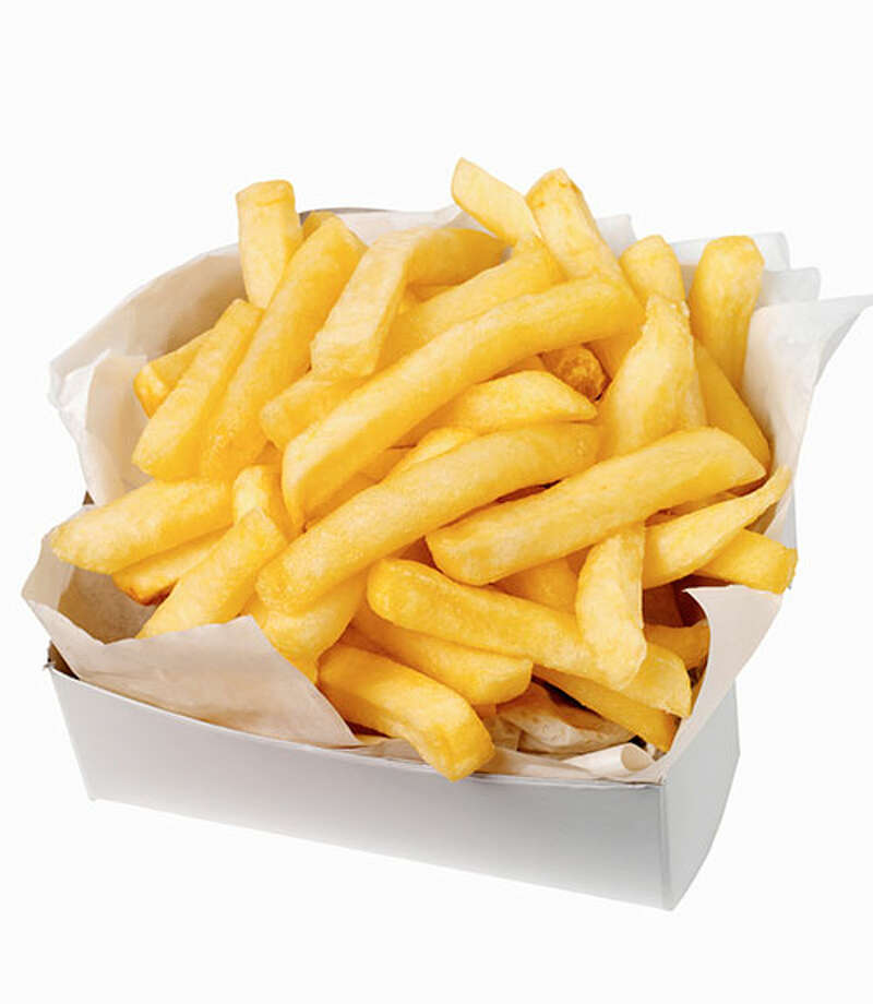 """Do you want fries with that? If you're hoping to get lucky, your man's  answer should be """"no."""" As with hot dogs, the trans-fat in fries can  negatively impact testosterone levels and circulation. Fries' high salt  content also can make it trickier for men with high blood pressure to  stay erect. For healthy folks, the sodium can bring on the not-so-sexy  sensation of bloating. If you're craving potato, eat a baked one  instead, suggests Dr. Richard. It releases the feel-good chemical  dopamine, improving your time between the sheets. Photo: Ciaran Griffin, Getty Images / (c) Ciaran Griffin"""