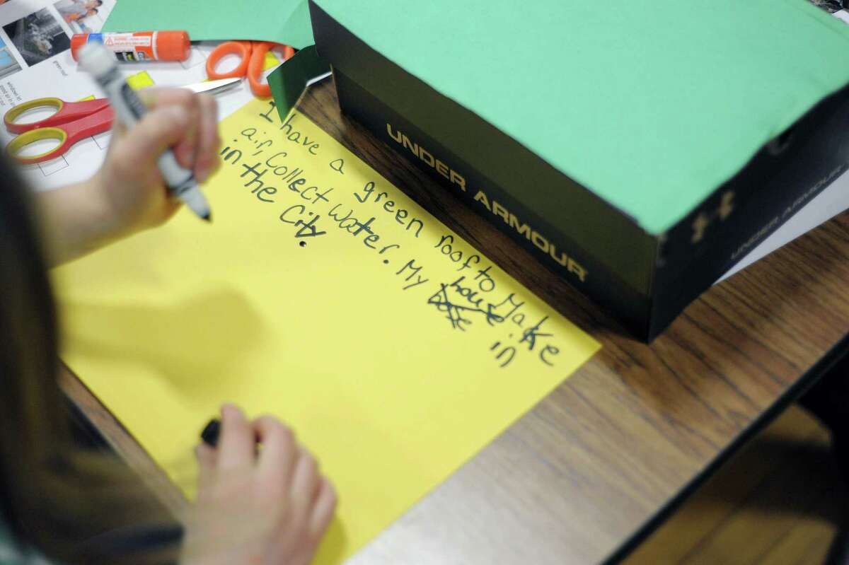 A student writes out information as she worked on building her own green building during a SmartKids NY, a science workshop on green technologies at Hamagrael Elementary School on Wednesday, April 10, 2013 in Delmar, NY. (Paul Buckowski / Times Union)