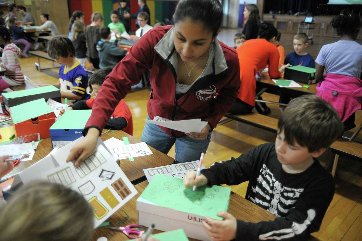 Indira Kumar, an RPI junior from Taunton, Mass., works with John Keeffe, 9, and other students as they build their own green building during a SmartKids NY, a science workshop on green technologies at Hamagrael Elementary School on Wednesday, April 10, 2013 in Delmar, NY. (Paul Buckowski / Times Union)