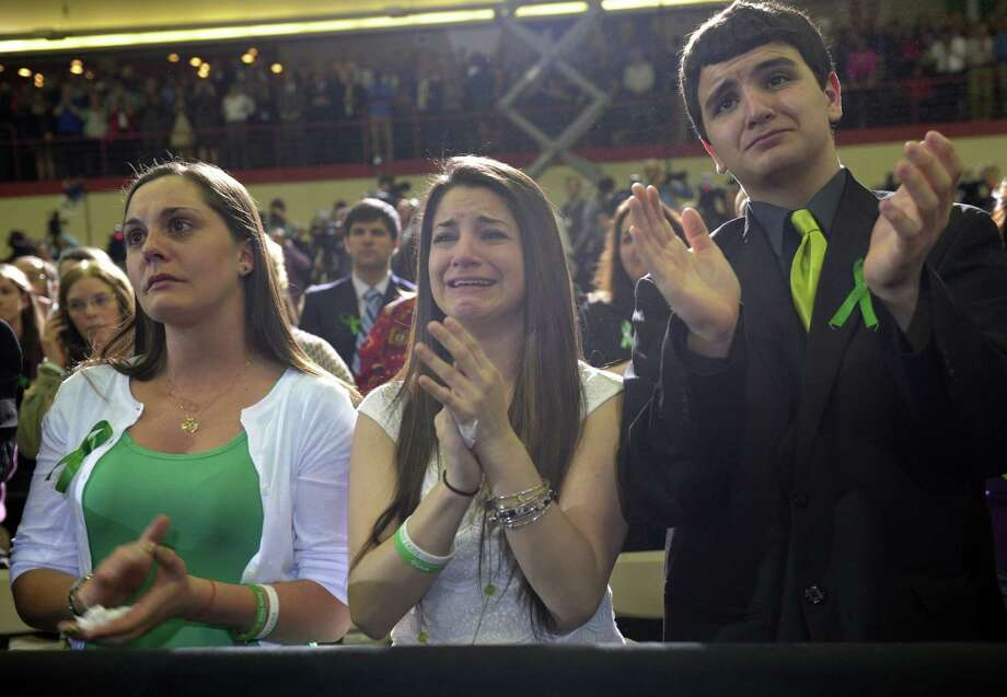 Karlee Soto (center), whose sister was killed in the Newtown, Conn., school shooting reacts as President Barack Obama speaks at the University of Hartford. He argued that lawmakers have an obligation to  victims of gun violence. Photo: Susan Walsh, Associated Press