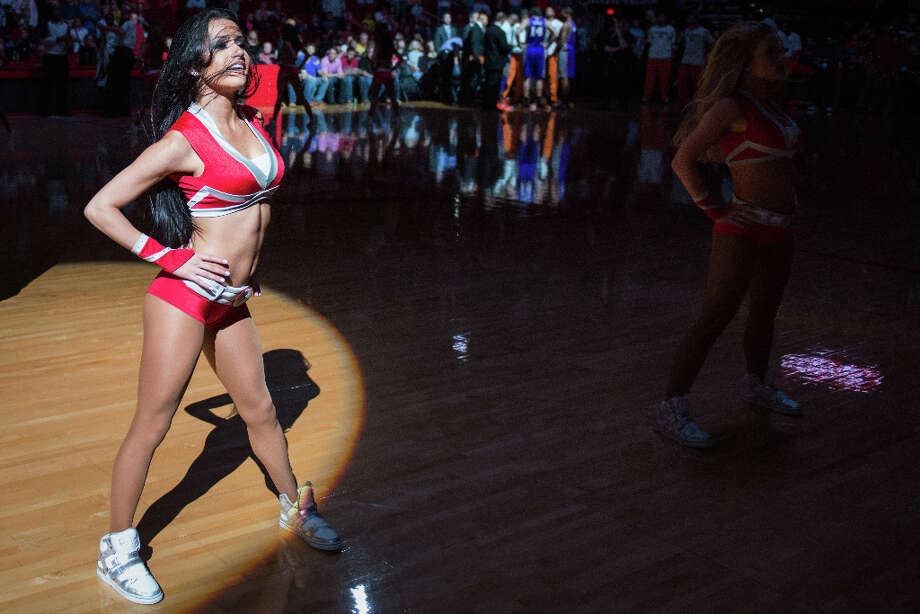 The Rockets Power Dancers perform during a basketball game between the Houston Rockets and the Phoenix Suns. Photo: Smiley N. Pool, Houston Chronicle / © 2013  Houston Chronicle