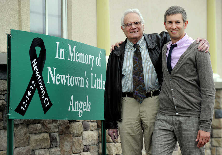 Dr. Fred Baff, left, and his son, Dr. Wesley Baff, run Plumtrees Animal Hospital in Danbury, Conn.  Wes is one of 12 men and women participating in a Ragnar Relay Race in May to raise money for the Jessica Rekos Memorial Fund. Jessica was a victim of the Sandy Hook school shootings. Photo: Carol Kaliff / The News-Times
