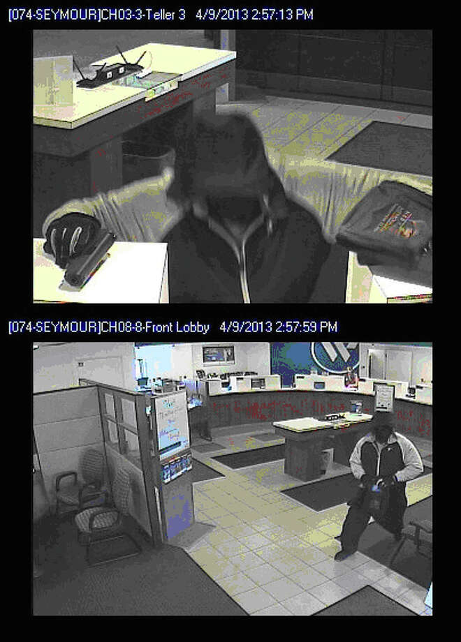 The Seymour Police Department investigating a robbery robbery which occurred at the Webster Bank located at 15 New Haven Rd., Seymour, Conn. on Tuesday, April 9th, 2013. Photo: Contributed Photo