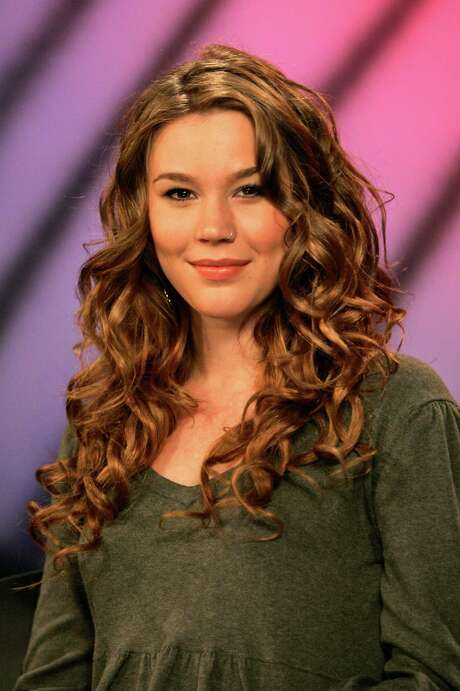 FILE - British singer Joss Stone is photographed after an interview,  in this Oct. 20, 2008 file photo taken in New York. British police have arrested two men Tuesday June 14, 2011 on suspicion of conspiracy to rob and murder near the rural home of singer Joss Stone. Devon and Cornwall Police say the men aged 30 and 33-years old were arrested Tuesday near Stone's house in Cullompton, southwest England after residents reported a suspicious-looking vehicle. (AP Photo/Mary Altaffer) Photo: Mary Altaffer, STF / AP2008