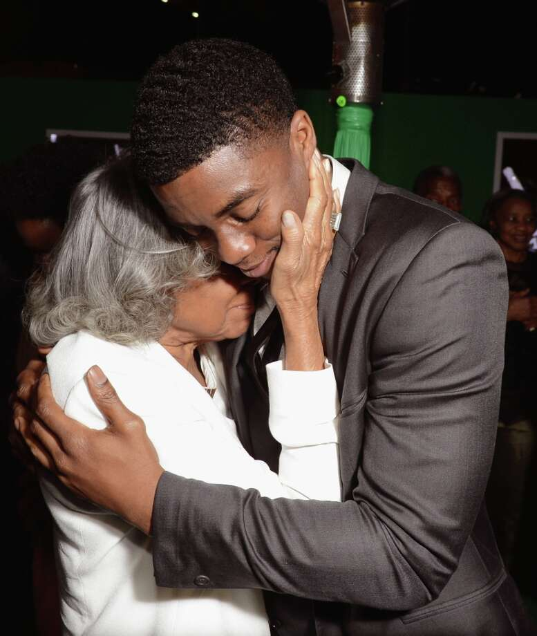 "Widow of baseball player Jackie Robinson, Rachel Robinson (L) and actor Chadwick Boseman attend the after party for the Los Angeles premiere of Warner Bros. Pictures\' and Legendary Pictures\' ""42\"" on April 9, 2013 in Hollywood, California. Photo: Kevin Winter, Getty Images / 2013 Getty Images"