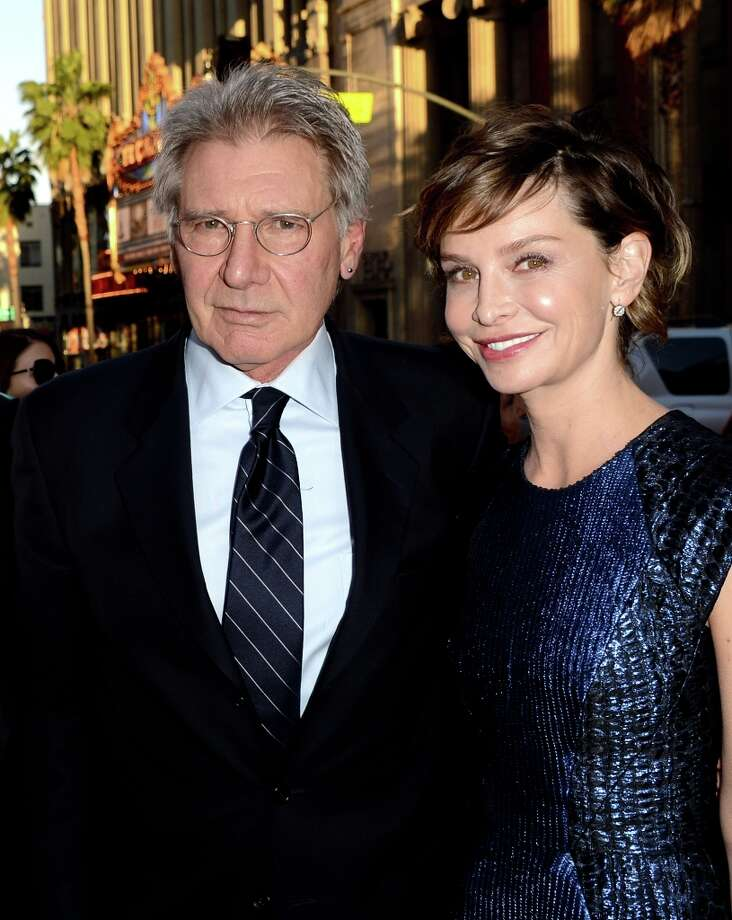 """Actor Harrison Ford (L) and his wife actress Calista Flockhart arrive at the premiere of Warner Bros. Pictures\' and Legendary Pictures\' \""""42\"""" at the Chinese Theatre on April 9, 2013 in Los Angeles, California. Photo: Kevin Winter, Getty Images / 2013 Getty Images"""