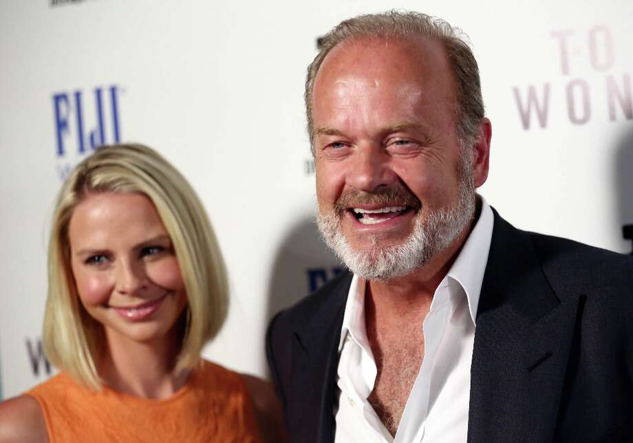 "Actor Kelsey Grammer, right, and Kayte Walsh arrive at the premiere of ""To The Wonder\"" hosted by FIJI Water on Tuesday, April 9, 2013 in Los Angeles. (Photo by Matt Sayles/Invision for Fiji Water/AP Images) Photo: Matt Sayles, Associated Press / Invision"
