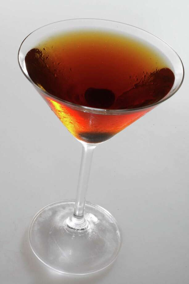The ManhattanFor an authentic Manhattan you need rye whiskey, but this recipe provides you with plenty of alternatives. As for the warmth, it may be served chilled, but that whisky will have your insides nice and toasty in no time. Photo: Eric Luse, SFC Staff / San Francisco Chronicle