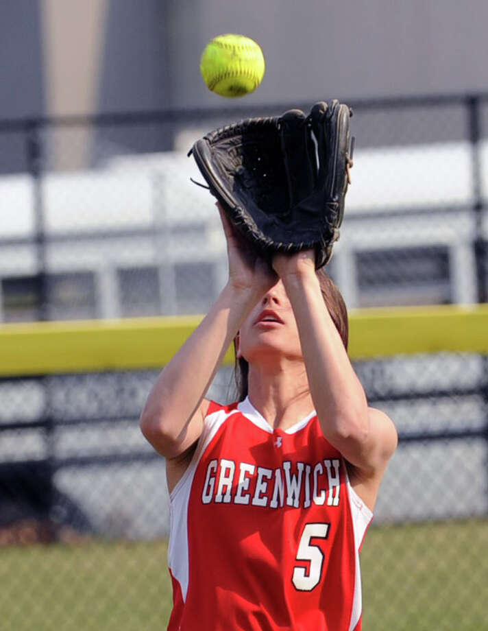 Jennifer Ambrogio of Greenwich makes a catch for an out in right field during the girls high school softball game between Greenwich High School and Stamford High School at Greenwich, Wednesday, April 10, 2013. Greenwich won the game 7-5 to remain unbeaten. Photo: Bob Luckey / Greenwich Time