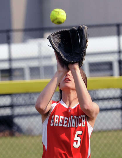 Jennifer Ambrogio of Greenwich makes a catch for an out in right field during the girls high school