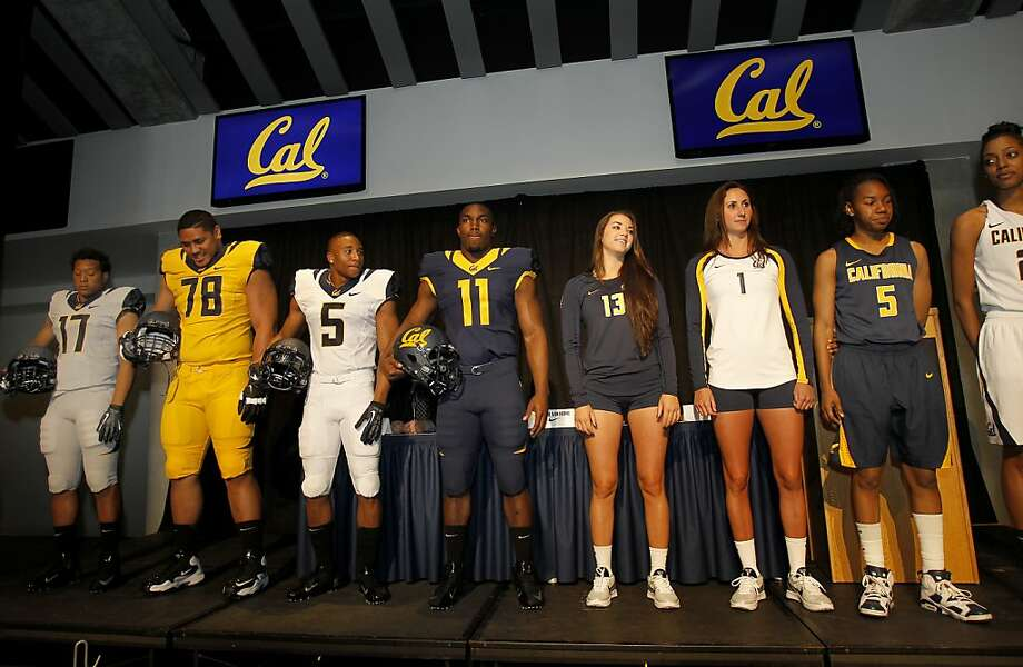 """Athletes model Cal's new Nike-provided football, volleyball and basketball uniforms that Nick Forbes (fourth from left) says have a """"nice, clean look."""" Photo: Brant Ward, The Chronicle"""