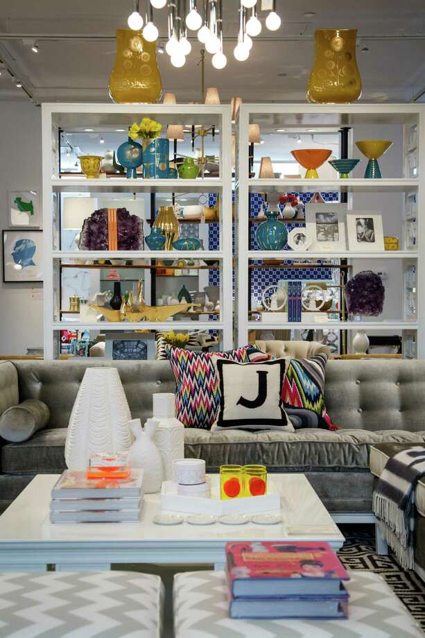 The new Jonathan Adler store in West Ave features vignettes such as a tufted gray sofa sitting on a patterned rug. Photo: Michael Paulsen, Staff / © 2013 Houston Chronicle