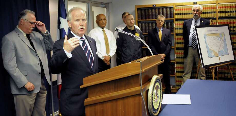 An announcement was made today by U.S.Attorney John M. Bales, second from left, Department of Justice, in regards to multiple arrests and the dismantling of major drug trafficking and money laundering organizations through the Eastern District of Texas. The people behind him are other members of organizations that are also involved. Eleven individuals have been indicted that were involved in the cocaine distribution ring, drugs and property have been seized, and more warrants are forthcoming. The case is the result of a joint investigation and the ongoing efforts of the Organized Crime Drug Enforcement Task Force(OCDETF).  Dave Ryan/The Enterprise