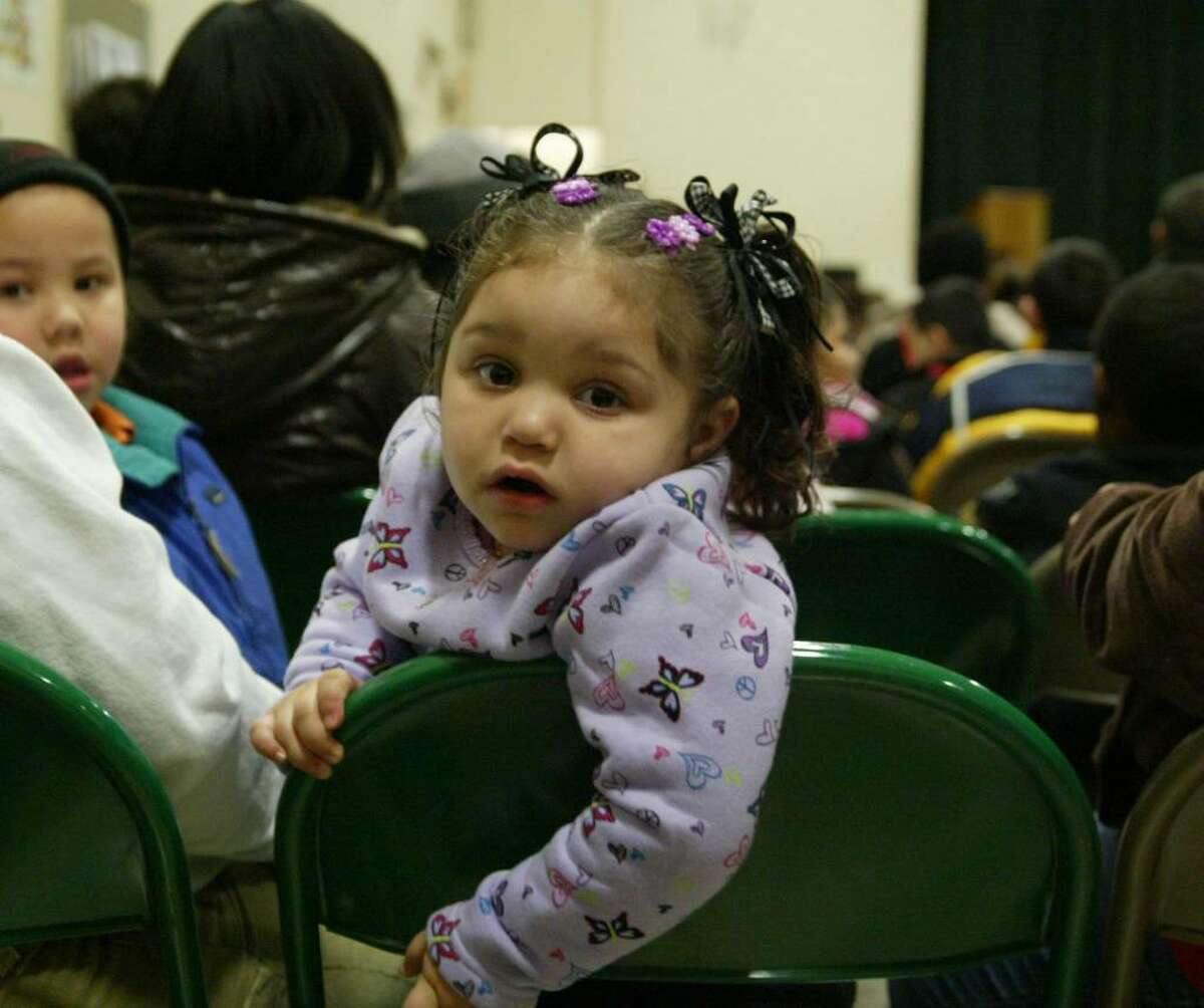 Skilyn Mary Santana, 2, watches for the Three KIngs before the annual Three Kings Celebration at Luis Munoz Marin School in Bridgeport. Wednesday, Jan. 6, 2010.