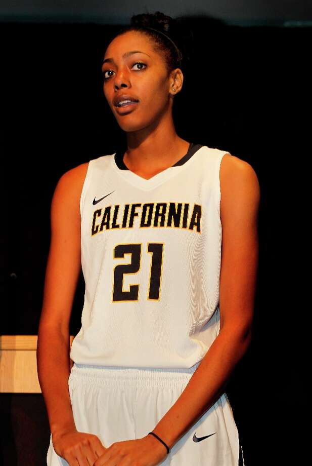 Kyra Dunn showed off the new women\'s basketball outfits. The University of California Athletic department unveiled its new uniforms Wednesday April 10, 2013 in Berkeley, Calif.  The new uniforms and visual identity was designed with Nike. Photo: Brant Ward, The Chronicle / ONLINE_YES