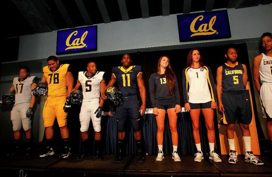 University athletes lined the stage to show off their new uniforms. The University of California Athletic department unveiled its new uniforms Wednesday April 10, 2013 in Berkeley, Calif.  The new uniforms and visual identity was designed with Nike. Photo: Brant Ward, The Chronicle / ONLINE_YES
