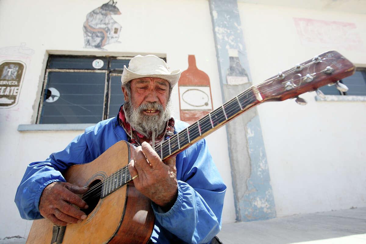 Joaquin Sanchez Luna, 83, performs outside the Park Bar Wednesday April 10, 2013 in Boquillas del Carmen, Mexico.