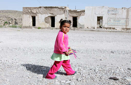 Maria Crisot Gonzalez Luna, 2, meanders along the main road Wednesday April 10, 2013 in Boquillas del Carmen, Mexico. Photo: Edward A. Ornelas, San Antonio Express-News / © 2013 San Antonio Express-News