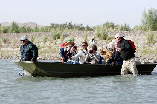 The first boat load of visitors crosses the Rio Grande from Big Bend National Park to Boquillas del Carmen, Mexico Wednesday April 10, 2013. Photo: Edward A. Ornelas, San Antonio Express-News / © 2013 San Antonio Express-News