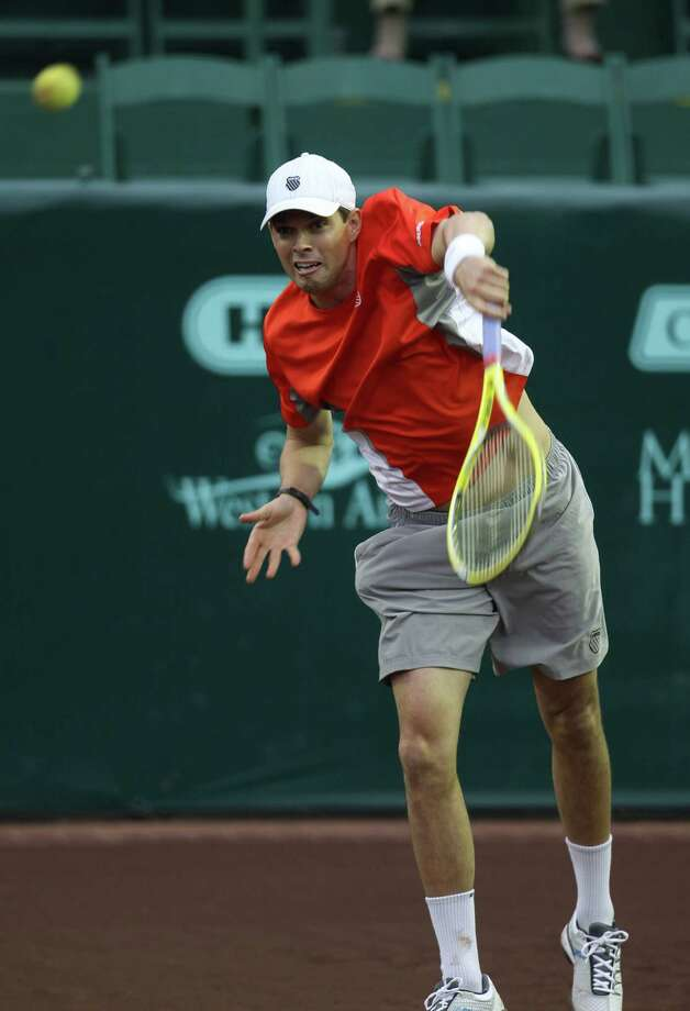Bob Bryan plays doubles with his brother, Mike (not in the photo) against Oliver Marach and Andre Sa, during the first round of the US Men's Clay Court Championships, Wednesday, April 10, 2013, in Houston. Photo: Karen Warren, Houston Chronicle / © 2013 Houston Chronicle